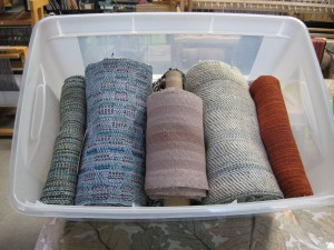 narrow handwoven fabric rolled and waiting