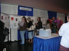Weavers perusing samples at Conference