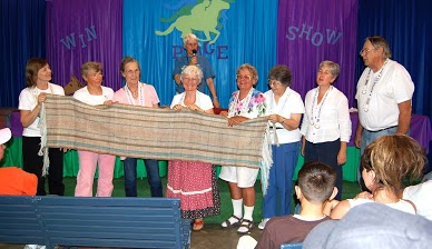 The Glenna Harris Sheep to Shawl Team with their finished product