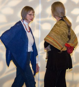 Judy Calder and friend show off her hand knitted shawls