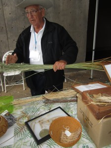 Justin Farmer discusses the juncus grass used in Ipai baskets.