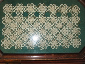 Family Heirlooms. A crocheted panel finding new purpose on a tray under glass.