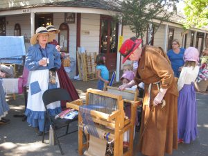 Evelyn Gordon and Sheila Stanger helping kids weave