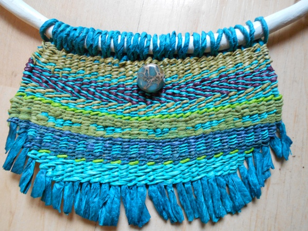Woven pendant of spun paper yarns, blue and green stripes