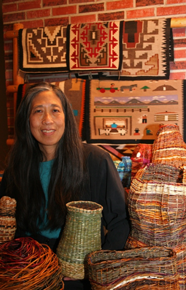 Photo of Donna Sakamoto Crispin, with basketry and weaving work
