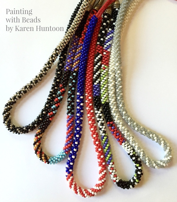 Multicolor strands of beaded kumihimo braids