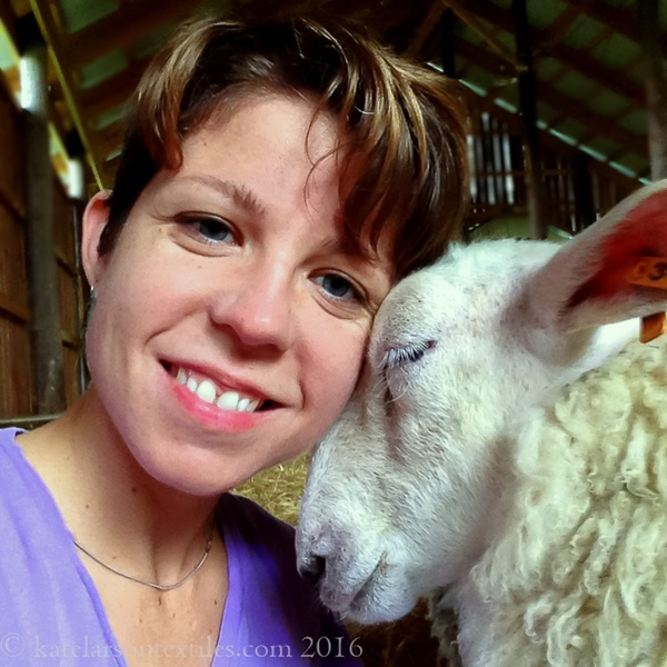 Photo of Kate Larson with a sheep