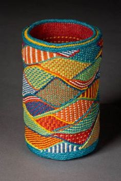 Cylindrical basket with tapestry-like wavy blocks of color