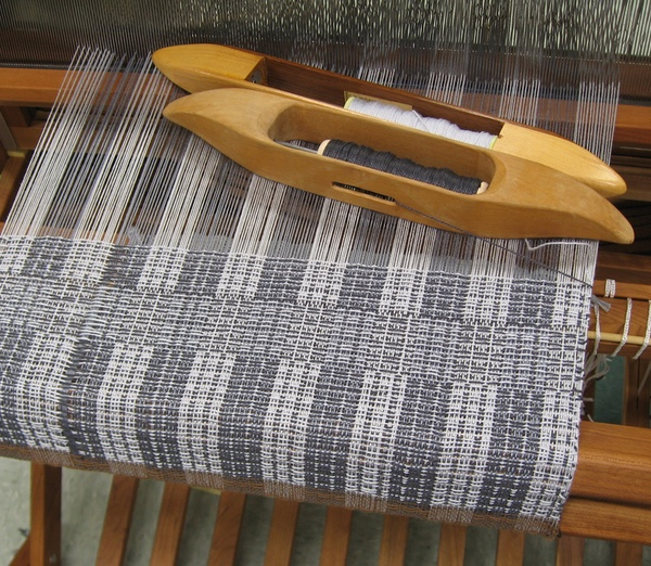Warp on the loom in a gray and white plaid