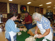 2016 Sheep to Shawl- Rebecca Salstrom, Ben Cohoon and Debra Pecaut are preparing to card fiber